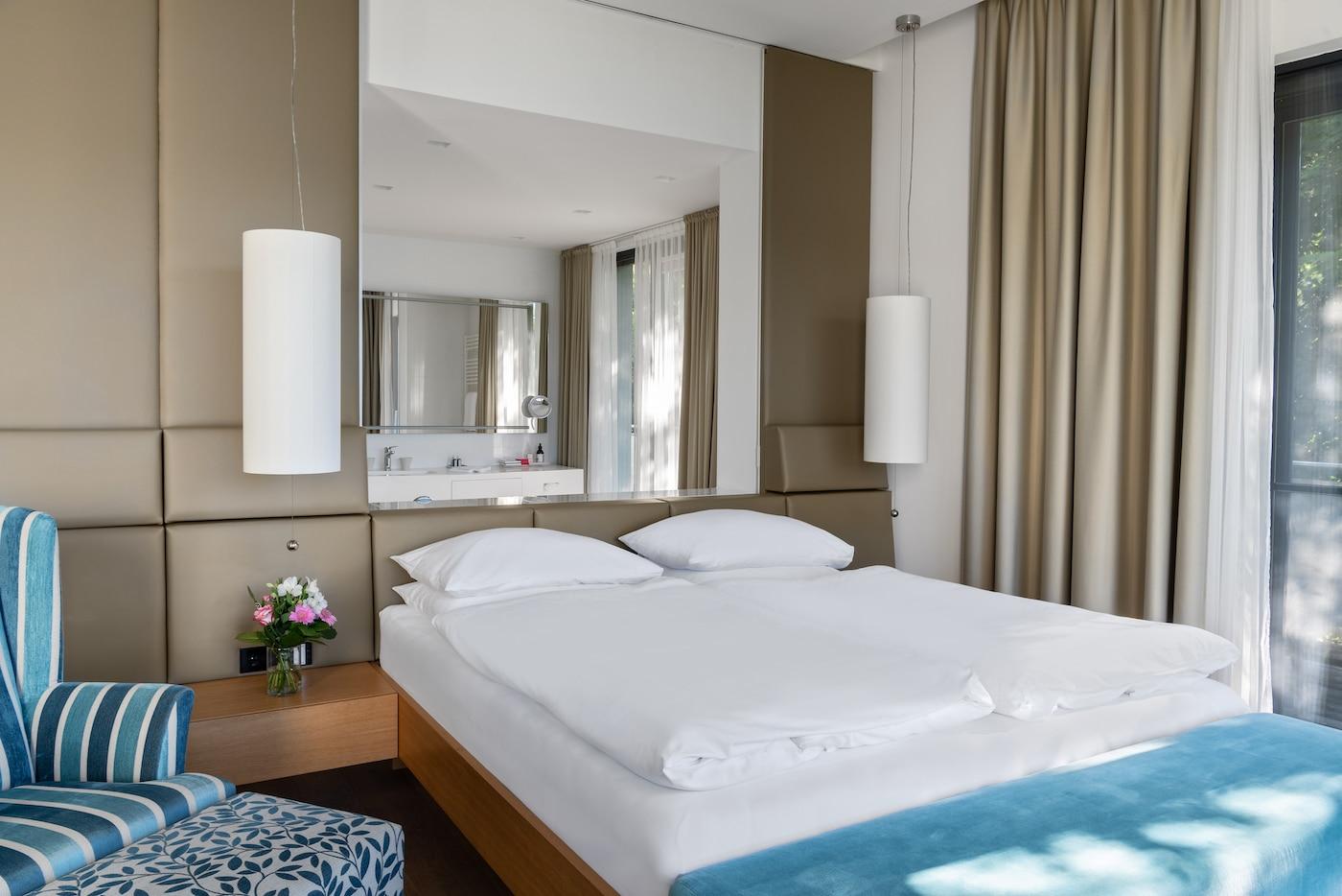 comfortable bed at Villa VIVAMAYR Maria Wörth