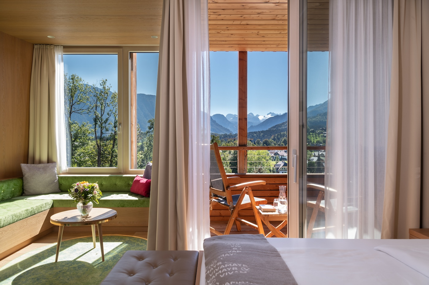 cosy bedroom in Comfort room with mountains view at VIVAMAYR Altausee