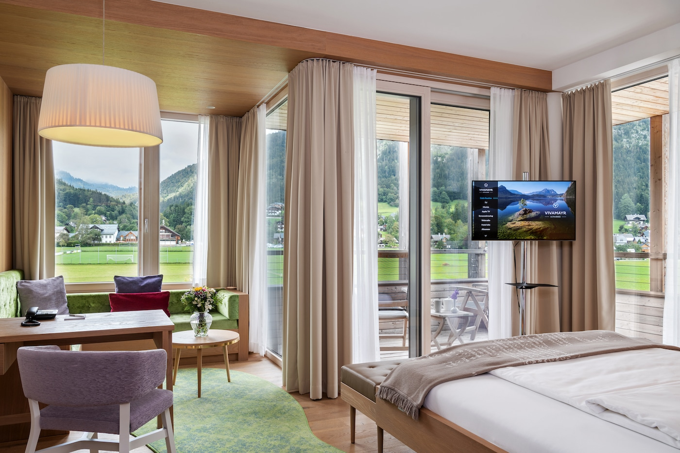 wide windows in Deluxe room with mountains view at VIVAMAYR Altausee