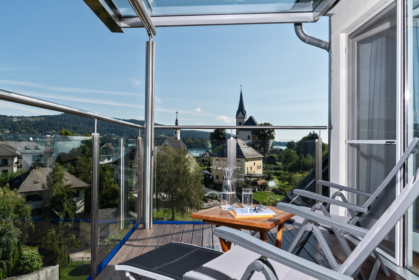 Balcony of Deluxe Suite VIVAMAYR Maria Wörth with village view