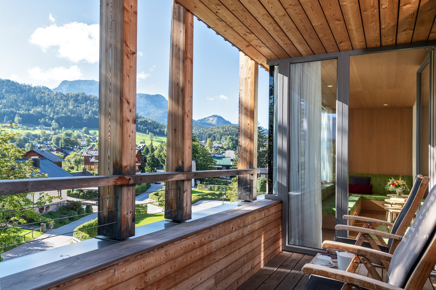 Balcony with village view in Junior Suite with mountains view VIVAMAYR Altausee