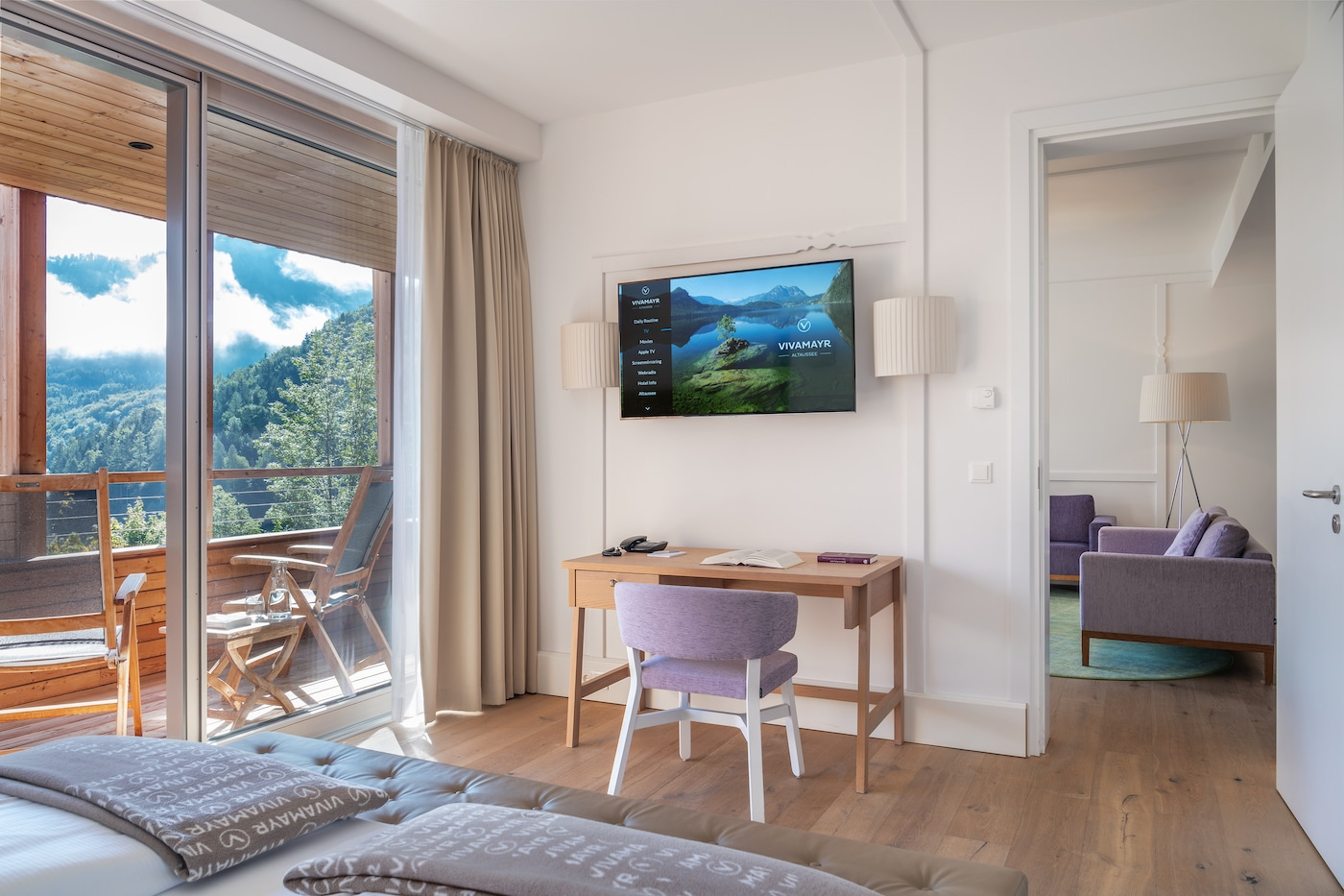 modern bedroom filled with light in Junior Suite with lake view VIVAMAYR Altausee
