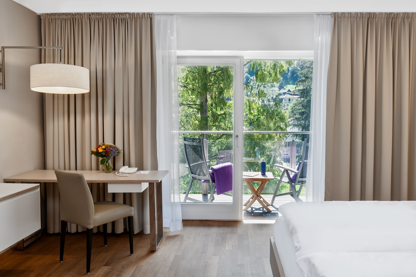 bright room with desk and chair in Comfort room with mountains view at VIVAMAYR Maria Wörth