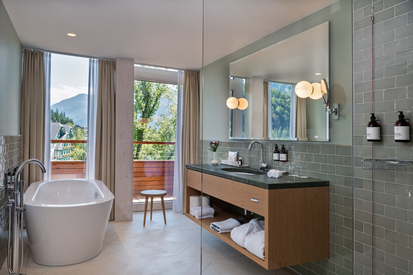 luxurious penthouse bathroom with bathtub with view of Styrian mountains