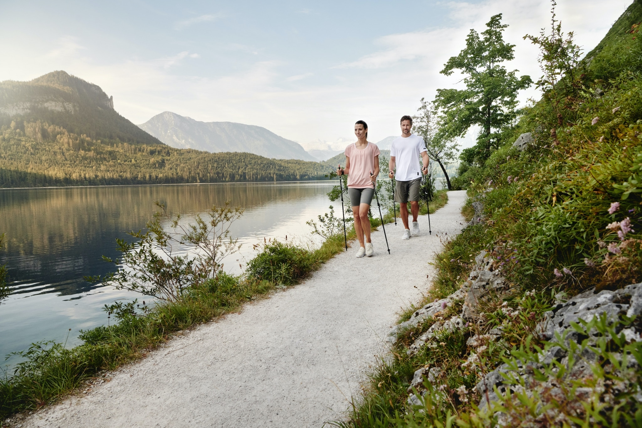Pair nordic walking along the lake Altaussee