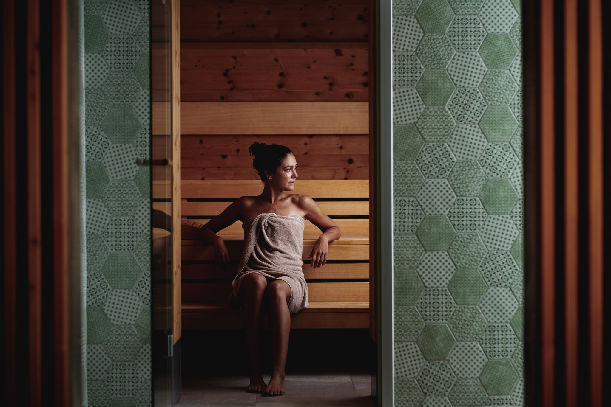 Female guest sitting in the sauna