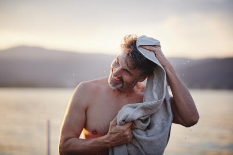 Man toweling himself at the lake