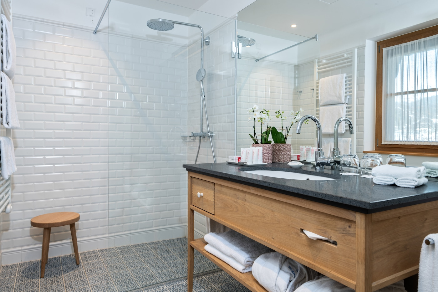 bathroom of a suite with shower and wooden washbasin