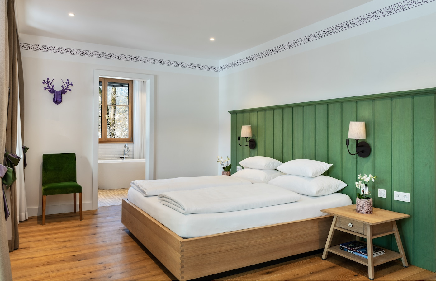 gorgeous bedroom of a suite with wooden wall