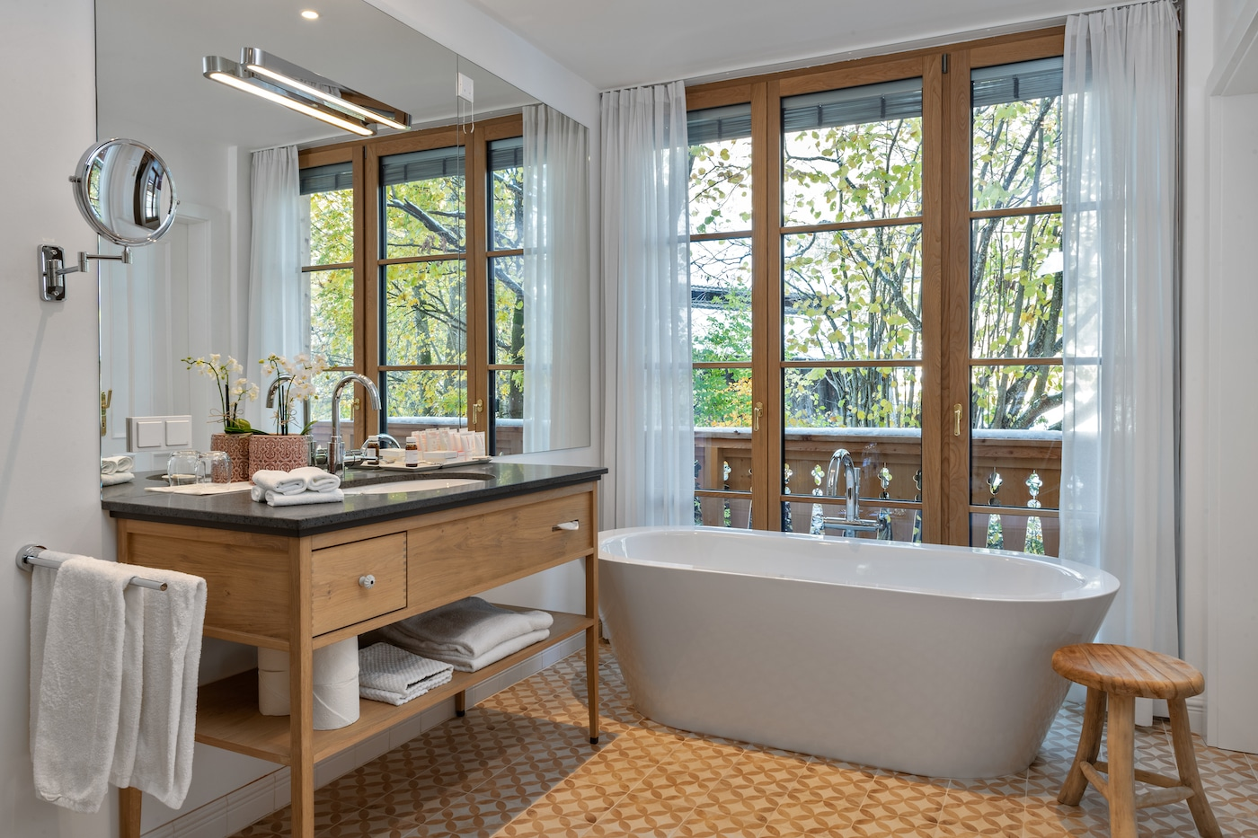 bathroom of a suite with bathtub and wooden washbasin