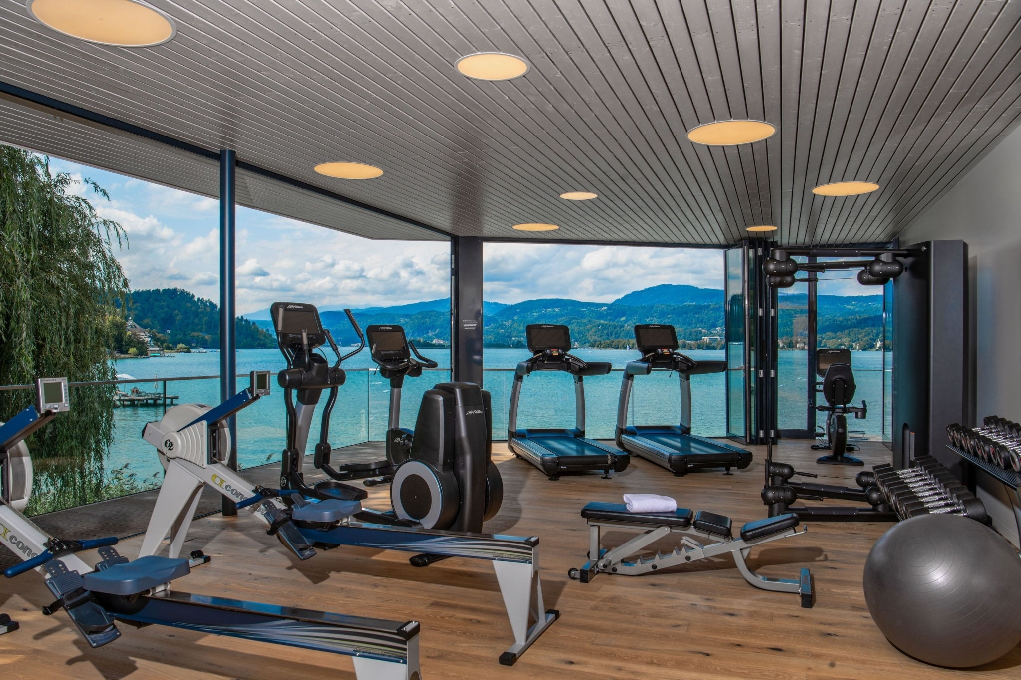 High quality gym with lots of equipment overlooking the lake Wörthersee
