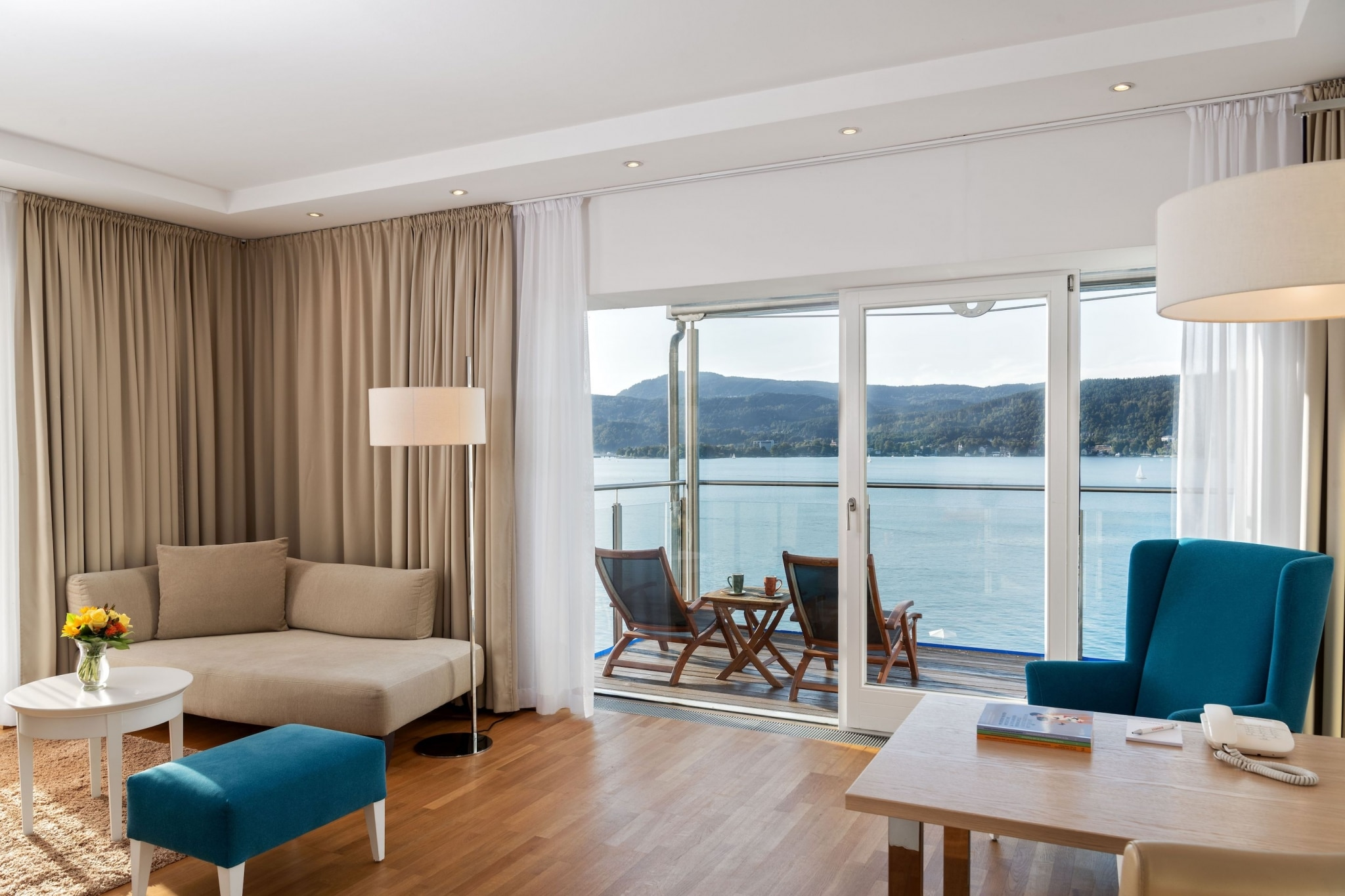 Luxurious suite with balcony and view of Lake Wörthersee