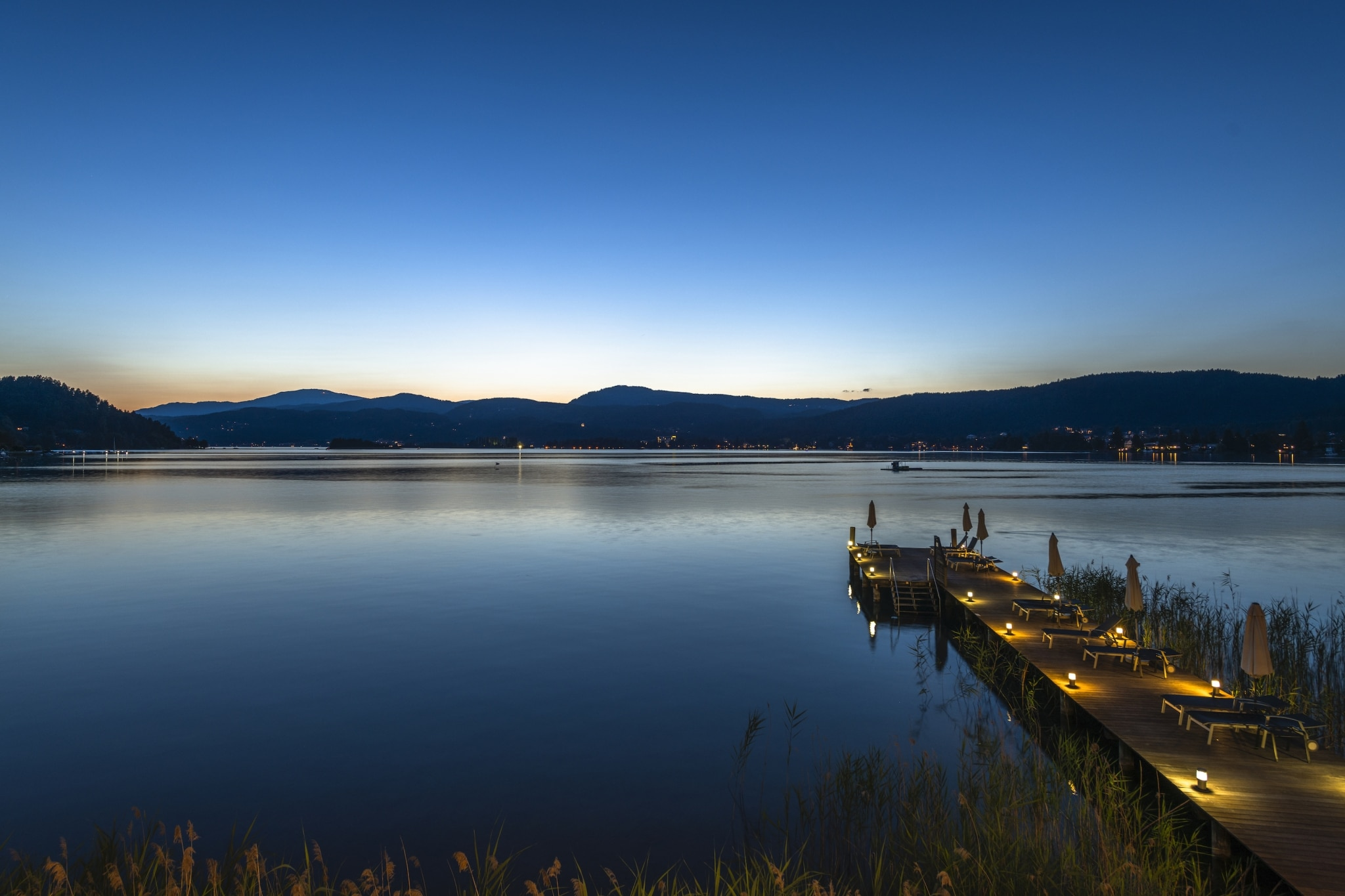 Breathtaking view of Lake Wörthersee during the sunset from VIVAMAYR Maria Wörth