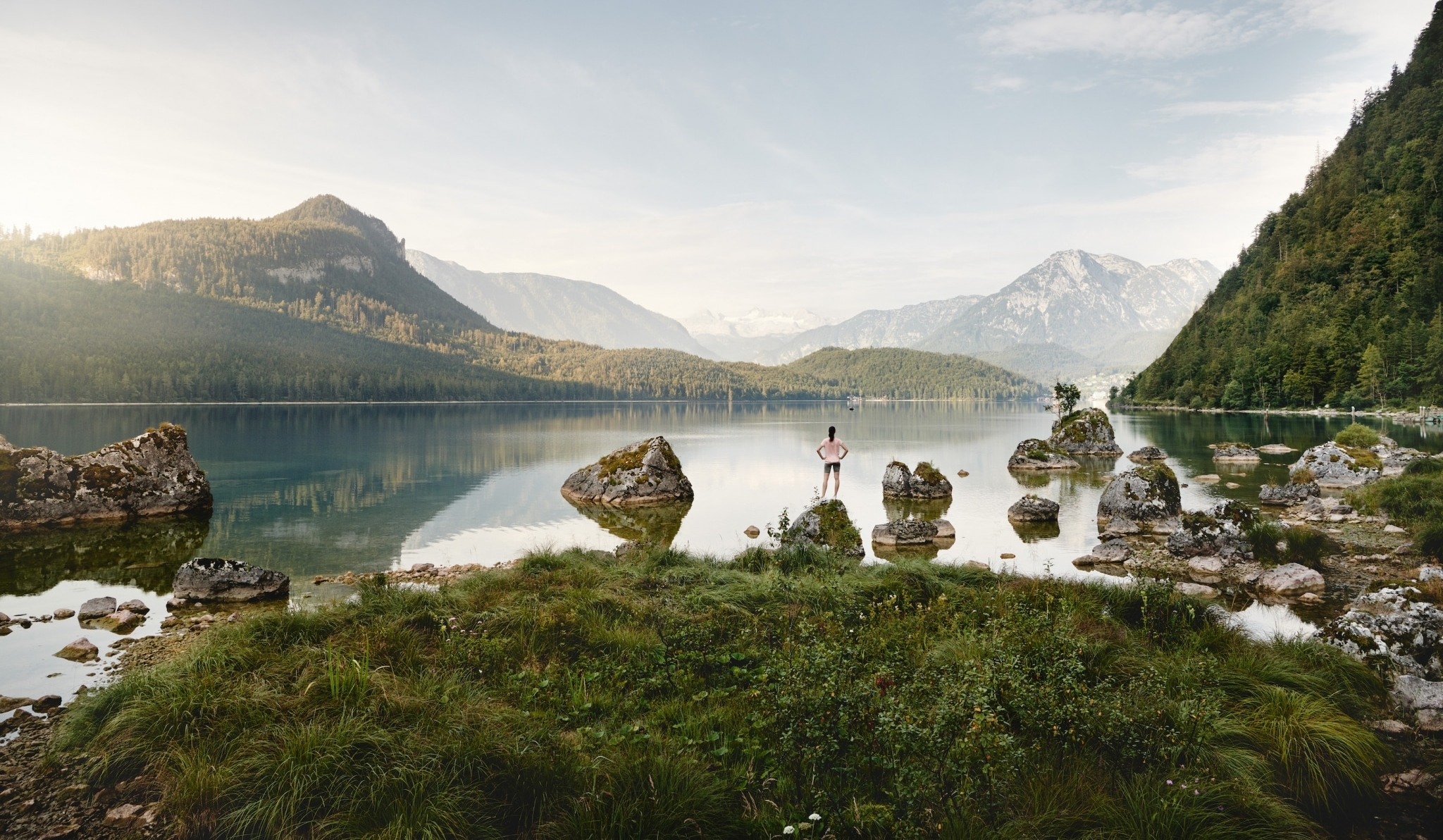 Woman enjoying the stunning view at the Lake Altaussee and the Styrian mountains