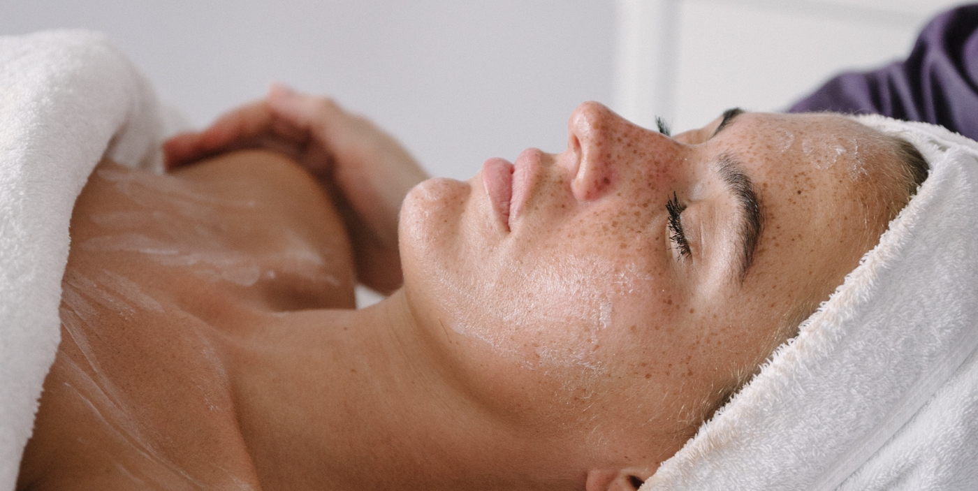 Woman has her eyes closed and enjoys her spa treatment